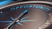 foto of compasses  - Compass with needle pointing the word opportunity concept image to illustrate business opportunities and strategy - JPG