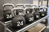 Heavy kettlebells weights in a workout gym