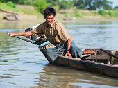 Burmese Helmsman On The Lemro River