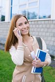Student Talking On Phone And Looking At Camera