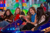 stock photo of carnival ride  - group of kids or girls having fun at fair - JPG