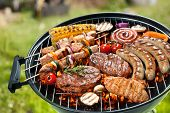 picture of grilled sausage  - Assorted delicious grilled meat with vegetable over the coals on a barbecue - JPG