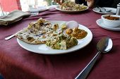 picture of indian  - Indian cuisine on red table in indian restaurant - JPG