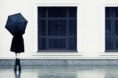 foto of rain  - Fashion woman with umbrella in the rain - JPG