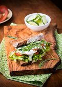 image of tomato sandwich  - Rye toast sandwich with green leaf tomato and chicken selective focus - JPG