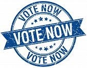 stock photo of voting  - vote now grunge retro blue isolated ribbon stamp - JPG