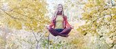 picture of levitation  - Levitation portrait of beautiful girl in the park - JPG