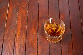 picture of tumblers  - Tumbler glass full of whisky standing on a wooden table - JPG