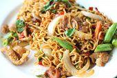 pic of stir fry  - Stir fried noodle spicy in pork on dish - JPG