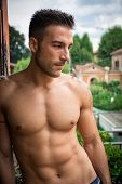 stock photo of single man  - Handsome shirtless muscular young man outdoor - JPG