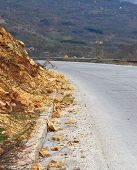stock photo of landslide  - picture of a landslide of rocks on the asphalt road - JPG