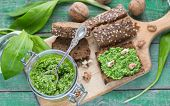 picture of pesto sauce  - Ramson wild garlic and sauce pesto on a wooden table - JPG