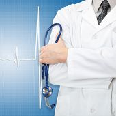 foto of electrocardiogram  - Doctor with stethoscope and electrocardiogram on blue background - JPG