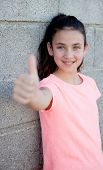 image of  preteen girls  - Portrait of a beautiful preteen girl with blue eyes saying Ok - JPG