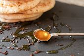 pic of maple syrup  - pancakes with honey and maple syrup with chocolate sprinkles - JPG