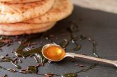 stock photo of maple syrup  - pancakes with honey and maple syrup with chocolate sprinkles - JPG