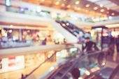 foto of department store  - Blur background photograph of people in the department store building with huge escalator in retro color - JPG