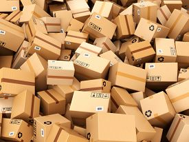stock photo of warehouse  - Stack of cardboard delivery boxes or parcels - JPG