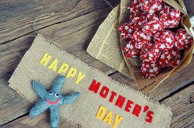 foto of starfish  - Happy mothers day with i love you mom message idea from colorful fabric starfish on wooden background beautiful flower abstract wooden texture mother - JPG