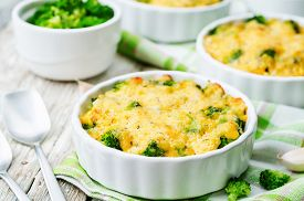 picture of millet  - millet casserole with broccoli and cheese on wooden background - JPG