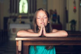 image of pray  - Cute kid girl praying in a church - JPG