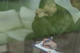 image of depressed  - Depressed glum soldier during therapy of depression - JPG