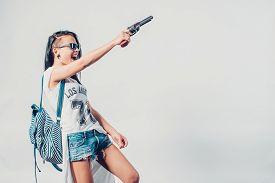 picture of hooligan  - Fashion swag sexy girl holding gun woman having fun  hooligan - JPG