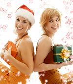 foto of christmas party  - tho beauties celebrating christmas surrounded by rendered snowflakes - JPG
