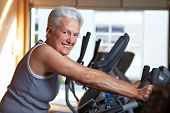 Senior Woman On Bike In Gym