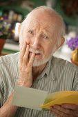 Senior Man With Sympathy Card