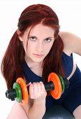 Beautiful Teenage Girl With Hand Weights