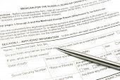 Aplicação de Medicaid e caneta prata