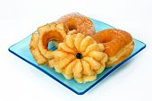 Donuts And Breakfast Pastries On A Blue Plate