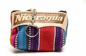 stock photo of memento  - souvenir memento key chain change purse hand made woven colorful fabric made in Nicaragua - JPG