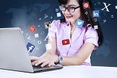 Постер, плакат: Young Businesswoman Using Social Network With Laptop