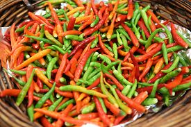 foto of red hot chilli peppers  - Heap of red and green Cayenne pepper is also called Guinea spice cow - JPG