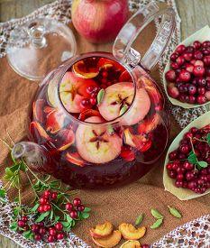 stock photo of cardamom  - Fruit tea from apples - JPG