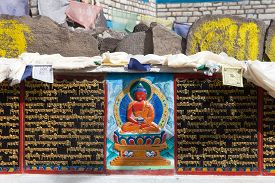 picture of tibetan  - buddhist mani prayer wall on the way to Everest base camp with buddhist tibetan symbols and prayer flags - JPG