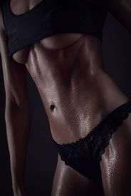 pic of abdominal  - Sporty Sexy Girl With Great Abdominal Muscles In Black Sportswear - JPG