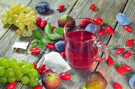picture of bag-of-dog-food  - Photo of dog rose tea and autumn fruits on a wooden tabe - JPG