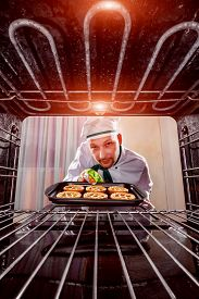 picture of pastry chef  - Chef prepares pastries in the oven - JPG