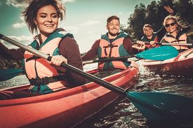 stock photo of kayak  - Group of happy people on a kayaks - JPG