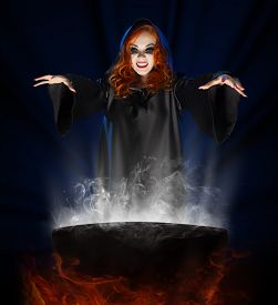 picture of cauldron  - Young witch with cauldron on blue rays background - JPG