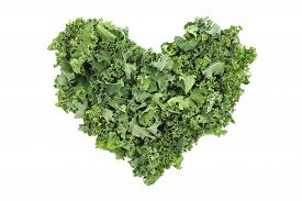 pic of cruciferous  - Chopped kale in a heart shape isolated on a white background - JPG