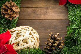 stock photo of poinsettia  - Christmas Decoration With Wicker Ball - JPG