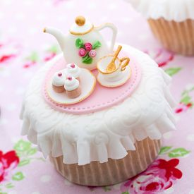 stock photo of sugarpaste  - Cupcake decorated with mini sugarpaste tea party - JPG