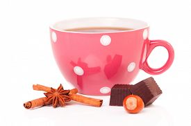 stock photo of filbert  - Big mug polka dot of tea with chocolate candy and filberts - JPG