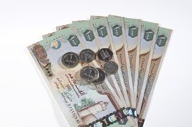 pic of dirhams  - One thousand Dirham currency notes and coins on white background - JPG