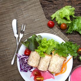 stock photo of sandwich wrap  - the fresh whole wheat bread wraps with vegetables and fruit on the plate healthy and clean food concept - JPG
