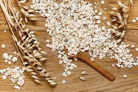 pic of oats  - Rolled oats and oat ears of grain on a wooden table - JPG